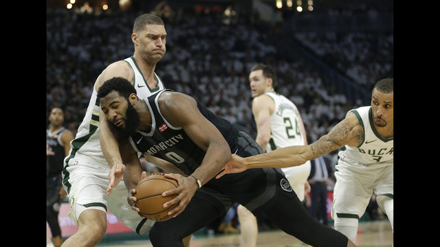 e7c475631d1 Detroit Pistons  Andre Drummond (0) is fouled as he drives between  Milwaukee Bucks  Brook Lopez and George Hill during the first half of Game  1 of an NBA ...