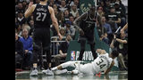 Milwaukee Bucks' Giannis Antetokounmpo (34) falls to the floor after being fouled by Detroit Pistons' Thon Maker (7) during the first half of Game 1 of an NBA basketball first-round playoff series Sunday, April 14, 2019, in Milwaukee. (AP Photo/Aaron Gash)