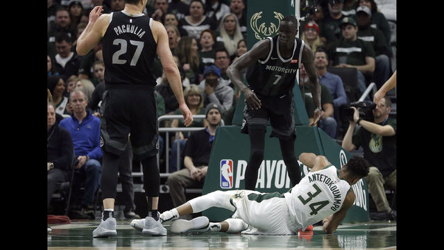 2c454c3fbf8 Milwaukee Bucks  Giannis Antetokounmpo (34) falls to the floor after being  fouled by Detroit Pistons  Thon Maker (7) during the first half of Game 1  of an ...