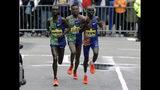 Kenneth Kipkemoi, left, of Kenya, Lelisa Desisa, center, of Ethiopia, and Lawrence Cherono, right, of Kenya, compete in the final mile of the 123rd Boston Marathon on Monday, April 15, 2019, in Boston. (AP Photo/Steven Senne)