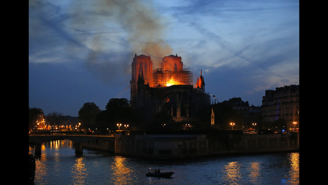 The Latest: French leader vows to rebuild damaged Notre Dame