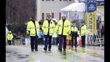 Massachusetts State Police walk the starting area of the 123rd Boston Marathon on Monday, April 15, 2019, in Hopkinton, Mass. (AP Photo/Stew Milne)