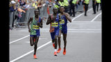 Kenneth Kipkemoi, left, and Lawrence Cherono, center, both of Kenya, and Lelisa Desisa, of Ethiopia, run the course during he 123rd Boston Marathon on Monday, April 15, 2019, in Boston. (AP Photo/Steven Senne)