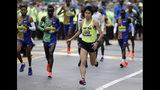 Yuki Kawauchi, of Japan, winner of the 2018 Boston Marathon, warms up before the start of the 123rd Boston Marathon on Monday, April 15, 2019, in Hopkinton, Mass. (AP Photo/Steven Senne)