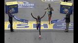Lawrence Cherono, of Kenya, breaks the tape to win the 123rd Boston Marathon in front of Lelisa Desisa, of Ethiopia, right, on Monday, April 15, 2019, in Boston. (AP Photo/Charles Krupa)