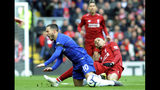 Chelsea's Eden Hazard, left, duels for the ball with Liverpool's Fabinho during the English Premier League soccer match between Liverpool and Chelsea at Anfield stadium in Liverpool, England, Sunday, April 14, 2019. (AP Photo/Rui Vieira)