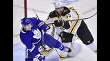 Boston Bruins defenseman Zdeno Chara (33) checks Toronto Maple Leafs left wing Zach Hyman (11) during first-period NHL playoff hockey action in Toronto, Monday, April 15, 2019. (Nathan Denette/The Canadian Press via AP)