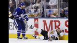 Toronto Maple Leafs left wing Zach Hyman (11) hits Boston Bruins right wing David Pastrnak (88) during first-period NHL playoff hockey action in Toronto, Monday, April 15, 2019. (Nathan Denette/The Canadian Press via AP)