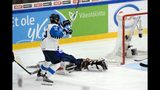 CORRECTS NAME OF FINNISH PLAYER TO PETRA NIEMINEN- Goalkeeper Alex Rigsby of the United States lies on the ice while Petra Nieminen of Finland starts celebrating her game-winning overtime goal which was later disallowed during the IIHF Women's Ice Hockey World Championships final match between the United States and Finland in Espoo, Finland, on Sunday, April 14, 2019. (Mikko Stig/Lehtikuva via AP)