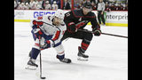 Carolina Hurricanes' Jordan Staal (11) defends against Washington Capitals' Chandler Stephenson (18) during the first period of Game 3 of an NHL hockey first-round playoff series in Raleigh, N.C., Monday, April 15, 2019. (AP Photo/Gerry Broome)