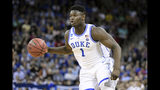 FILE - In this March 24, 2019, file photo, Duke forward Zion Williamson (1) dribbles the ball against Central Florida during the first half of a second-round game in the NCAA men's college basketball tournament in Columbia, S.C. Williamson was named the John R. Wooden Men's Player of the year at the College Basketball Awards ceremony in Los Angeles, Friday, April 12, 2019. (AP Photo/Sean Rayford, File)