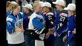 Goalkeeper Noora R'ty (41) of Finland followed by Noora Tulus (24) congratulates US players for their 2-1 shootout victory after the IIHF Women's Ice Hockey World Championships final match between the United States and Finland in Espoo, Finland, on Sunday, April 14, 2019. (Mikko Stig/Lehtikuva via AP)