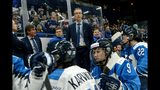 Finnish head coach Pasi Mustonen and players look dejected after their 2-1 shootout loss in the IIHF Women's Ice Hockey World Championships final match between the United States and Finland in Espoo, Finland, on on Sunday, April 14, 2019. (Mikko Stig/Lehtikuva via AP)