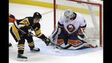 New York Islanders goaltender Robin Lehner (40) stops a shot by Pittsburgh Penguins' Sidney Crosby (87) during the third period in Game 3 of an NHL first-round hockey playoff series in Pittsburgh, Sunday, April 14, 2019. (AP Photo/Gene J. Puskar)