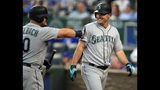 Seattle Mariners' Jay Bruce, right, is congratulated by teammate Daniel Vogelbach, left, after his solo home run during the first inning of a baseball game against the Kansas City Royals at Kauffman Stadium in Kansas City, Mo., Tuesday, April 9, 2019. (AP Photo/Orlin Wagner)