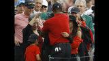 Tiger Woods hugs his family after winning the Masters golf tournament Sunday, April 14, 2019, in Augusta, Ga. (AP Photo/Matt Slocum)