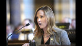 In this Jan. 25, 2019 photo, Neb. State Sen. Anna Wishart of Lincoln testifies during a legislative hearing in Lincoln, Neb., on LB 110, a bill that proposes to legalize medical marijuana in Nebraska. Nebraska's conservative lawmakers are poised to once again reject measures calling for allowing limited and highly regulated use of medical marijuana, but their decision this year could have the unintended consequence of ushering in one of the most unrestricted medical marijuana laws in the country. (AP Photo/Nati Harnik)