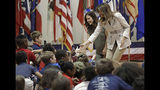 First lady Melania Trump, right, and second lady Karen Pence, left, greet student at Albritton Middle School in Fort Bragg, N.C., Monday, April 15, 2019. (AP Photo/Chuck Burton)