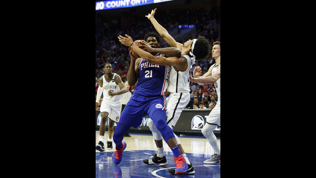 97d73555d4a Philadelphia 76ers' Joel Embiid, left, of Cameroon, with the flaguant 1  foul on Brooklyn Nets' Jarrett Allen, right, as he was going for the shot  during the ...