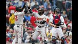 Baltimore Orioles' Dwight Smith, center, celebrates his two-run home run that also drove in Jonathan Villar, left, as Boston Red Sox catcher Blake Swihart, right, looks away during the fifth inning of a baseball game in Boston, Monday, April 15, 2019. (AP Photo/Michael Dwyer)