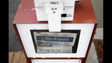 A copy of the day's Capital Gazette newspaper rests in a newsstand, Monday, April 15, 2019, in Annapolis, Md. The Pulitzer Prize board awarded the Capital Gazette a special citation Monday for their response to a 2018 shooting that left five employees dead. (AP Photo/Patrick Semansky)