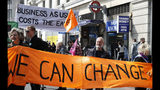 "Climate change protesters hold up a banner saying 'We can Change"" during a demonstration in London, Monday, April 15, 2019. Extinction Rebellion have organised a nationwide week of action, they are calling for a full-scale Rebellion to demand decisive action from governments on climate change and ecological collapse. They plan to engage in acts of non-violent civil disobedience against governments in capital cities around the world. (AP Photo/Alastair Grant)"