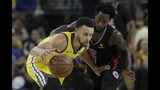 Golden State Warriors guard Stephen Curry, left, is defended by Los Angeles Clippers guard Patrick Beverley during the first half of Game 2 of a first-round NBA basketball playoff series in Oakland, Calif., Monday, April 15, 2019. (AP Photo/Jeff Chiu)
