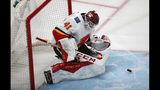 Calgary Flames goaltender Mike Smith stops a shot by the Colorado Avalanche in the first period of Game 3 of a first-round NHL hockey playoff series Monday, April 15, 2019, in Denver. (AP Photo/David Zalubowski)