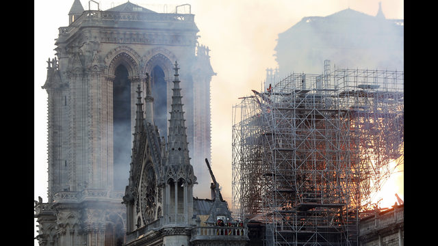 1af128830e96 Firefighters tackle the blaze as flames and smoke rise from Notre Dame  cathedral as it burns in Paris