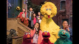 "This image released by HBO shows the cast of the popular children's show ""Sesame Street."" Big Bird, Elmo and stars of ""Sesame Street"" are leaving their quiet neighborhood and hitting the road. The non-profit Sesame Workshop said Tuesday a selection of Muppets will embark on a 10-city trip to celebrate the show's 50th anniversary campaign with free park festivals, live performances and kid-friendly activities. (HBO via AP)"