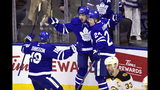 Toronto Maple Leafs center Auston Matthews (34) celebrates his goal with teammates Andreas Johnsson (18) and right wing Kasperi Kapanen (24) as Boston Bruins defenseman Zdeno Chara (33) skates away during the second period of Game 4 of an NHL hockey first-round playoff series Wednesday, April 17, 2019, in Toronto. (Frank Gunn/The Canadian Press via AP)