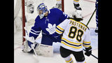 Toronto Maple Leafs goaltender Frederik Andersen (31) looks for the puck as Boston Bruins right wing David Pastrnak (88) scores during the second period of Game 4 of an NHL hockey first-round playoff series Wednesday, April 17, 2019, in Toronto. (Frank Gunn/The Canadian Press via AP)