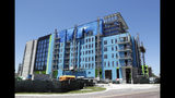 In this Tuesday, April 16, 2019, photo, an apartment building under construction nears completion in downtown Orlando, Fla. The U.S. Census Bureau said Thursday, April 18 that Orlando grew by 60,000 people from mid-2017 to mid-2018, making it the fifth biggest metro increase in pure numbers in the nation. (AP Photo/John Raoux)