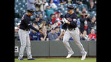Cleveland Indians' Jake Bauers, right, is congratulated by third base coach Mike Sarbaugh after Bauers' solo home run against the Seattle Mariners during the fifth inning of a baseball game Wednesday, April 17, 2019, in Seattle. (AP Photo/Elaine Thompson)