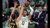 Boston Celtics forward Jayson Tatum (0) looks to pass as he is pressured by Indiana Pacers forward Bojan Bogdanovic (44) during the first quarter of Game 2 of an NBA basketball first-round playoff series, Wednesday, April 17, 2019, in Boston. At right is Boston Celtics head coach Brad Stevens. (AP Photo/Charles Krupa)