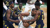 Boston Celtics center Al Horford, is trapped by Indiana Pacers forward Thaddeus Young, right, during the first quarter of Game 2 of an NBA basketball first-round playoff series, Wednesday, April 17, 2019, in Boston. At left is Indiana Pacers center Myles Turner and Indiana Pacers guard Darren Collison (2)(AP Photo/Charles Krupa)