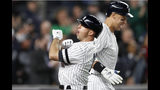 New York Yankees Brett Gardner, left, celebrates with Yankees Aaron Judge, right, during the seventh inning of a baseball game against the Boston Red Sox, Wednesday, April 17, 2019, in New York. (AP Photo/Kathy Willens)