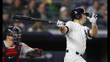Boston Red Sox catcher Christian Vazquez (7) and New York Yankees Brett Gardner watch Gardner's grand slam during the seventh inning of a baseball game, Wednesday, April 17, 2019, in New York. (AP Photo/Kathy Willens)