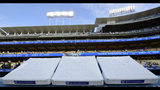 Bases bearing Jackie Robinson's name wait to be installed on Jackie Robinson Day prior to a baseball game between the Los Angeles Dodgers and the Cincinnati Reds, Monday, April 15, 2019, in Los Angeles. (AP Photo/Mark J. Terrill)