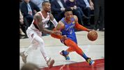 Oklahoma City Thunder guard Russell Westbrook, right, dribbles past Portland Trail Blazers guard Damian Lillard during the first half of Game 2 of an NBA basketball first-round playoff series Tuesday, April 16, 2019, in Portland, Ore. (AP Photo/Craig Mitchelldyer)
