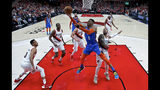 Oklahoma City Thunder guard Russell Westbrook, center, shoots over Portland Trail Blazers guard Damian Lillard, right, during the first half of Game 2 of an NBA basketball first-round playoff series Tuesday, April 16, 2019, in Portland, Ore. (AP Photo/Craig Mitchelldyer)