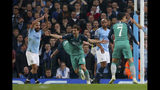 Tottenham's Fernando Llorente, second left, celebrates scoring his side's third goal as Manchester City's Sergio Aguero, left, appeals for handball watched by Manchester City's Vincent Kompany, second right, during the Champions League quarterfinal, second leg, soccer match between Manchester City and Tottenham Hotspur at the Etihad Stadium in Manchester, England, Wednesday, April 17, 2019. (AP Photo/Dave Thompson)