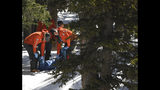 "Members of an Alpine Rescue Team carry out the body of 18-year-old Sol Pais, near Echo Lake Campground in Arapaho National Forest, Wednesday, April 17, 2019, in Idaho Springs, Colo. The young Florida woman who authorities say was so ""infatuated"" with the Columbine school shooting they feared she was planning an attack in Colorado just days ahead of the 20th anniversary was found dead Wednesday in an apparent suicide after a nearly 24-hour manhunt. (RJ Sangosti/The Denver Post via AP)"