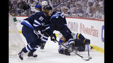 St. Louis Blues defenseman Colton Parayko (55) gets tangled up with Winnipeg Jets right wing Blake Wheeler (26) as Jets left wing Kyle Connor (81) picks up the loose puck during the second period of Game 5 of an NHL hockey first-round playoff series Thursday, April 18, 2019, in Winnipeg, Manitoba. (John Woods/The Canadian Press via AP)