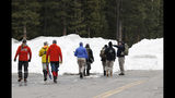 "Investigators head into the forest along Mount Evans Road Wednesday, April 17, 2019, near Idaho Springs, Colo. A young Florida woman who authorities say was so ""infatuated"" with the Columbine school shooting they feared she was planning an attack in Colorado just days ahead of the 20th anniversary was found dead Wednesday in an apparent suicide after a nearly 24-hour manhunt. Authorities gave no immediate details on where 18-year-old Sol Pais was found, but FBI agents had focused the search around the base of Mount Evans, a popular recreation area about 60 miles southwest of Denver. (AP Photo/David Zalubowski)"