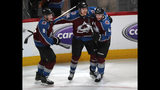 Colorado Avalanche right wing Mikko Rantanen, center, celebrates his overtime goal with defensemen Cale Makar, left, and Tyson Barrie in Game 4 of an NHL hockey playoff series against the Calgary Flames on Wednesday, April 17, 2019, in Denver. The Avalanche won 3-2. (AP Photo/David Zalubowski)