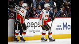 Calgary Flames center Elias Lindholm, right, celebrates his goal with left wing Johnny Gaudreau during the second period of Game 4 of an NHL hockey playoff series against the Colorado Avalanche on Wednesday, April 17, 2019, in Denver. (AP Photo/David Zalubowski)