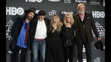 FILE - This March 29, 2019 file photo shows Inductee Stevie Nicks, center, posing with other members of Fleetwood Mac, from left, Mike Campbell, John McVie, Christine McVie and Mick Fleetwood at the Rock & Roll Hall of Fame induction ceremony in New York. Fleetwood Mac has announced rescheduled dates for its North America tour which were postponed earlier this month because singer Stevie Nicks had the flu. The Grammy-winning band is set to play Boston on Oct. 28 and Philadelphia on Nov. 3. Canadian dates include Quebec City on Oct. 30, Toronto and Nov. 1, Winnipeg of Nov. 7, Calgary on Nov. 10 and Edmonton on Nov. 30. (Photo by Charles Sykes/Invision/AP, File)