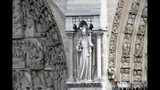 "A statue is pictured just outside Notre Dame cathedral Wednesday, April 17, 2019 in Paris. Notre Dame Cathedral would have been completely burned to the ground in a ""chain reaction collapse"" had firefighters not moved rapidly in deploying their equipment to battle the blaze racing through the landmark monument, a Paris official said Wednesday. (AP Photo/Thibault Camus)"