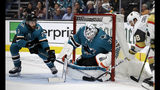 San Jose Sharks' Barclay Goodrow, left, and Martin Jones, center, defend on a shot from Vegas Golden Knights' William Carrier, right, during the second period of Game 5 of an NHL hockey first-round playoff series Thursday, April 18, 2019, in San Jose, Calif. (AP Photo/Ben Margot)